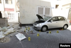 Crime scene markers are seen at a bomb site in capital of Manama, Bahrain, November 5, 2012. Five bombs exploded in the heart of Manama Monday, killing two people, officials said.