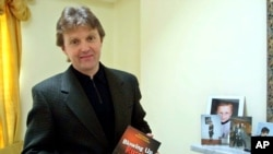 "FILE - Alexander Litvinenko, former KGB spy and author of the book ""Blowing Up Russia: Terror From Within"" photographed at his home in London, May 10, 2002. Andrei Lugovoi is a prime suspect in his poisoning."