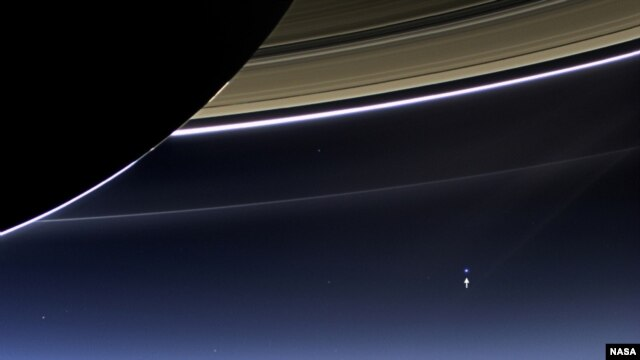 In this rare image taken on July 19, 2013, the wide-angle camera on NASA's Cassini spacecraft has captured Saturn's rings and our planet Earth and its moon in the same frame. (NASA/JPL-Caltech/Space Science Institute)