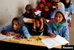 FILE - Afghan girls attend a class at the Aschiana center in Kabul, Afghanistan March 5, 2019.