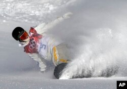 Sweden's Niklas Mattsson finishes his first run during men's snowboard slopestyle qualifying at the Rosa Khutor Extreme Park ahead of the 2014 Winter Olympics, Feb. 6, 2014, in Krasnaya Polyana, Russia.