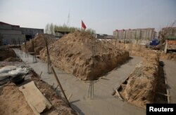 A construction site is pictured after it was stopped by local government on the outskirts of Xiongxian county, one part of the new special economic zone Xiong'an New Area, Hebei province, China April 3, 2017.