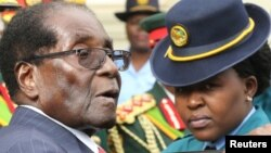 FILE: President Robert Mugabe leaves the parliament building after delivering his State Of the Nation address in Harare, Zimbabwe, Dec. 6, 2016.