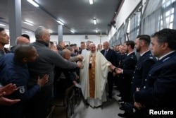 Pope Francis greets inmates and guards as he arrives to celebrate the Holy Thursday at the District House of Velletri prison, in Velletri near Rome, Italy, April 18, 2019.