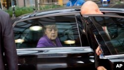 La canciller alemana Angela Merkel llega a una reunión en Bruselas. La pregunta es ahora, cuándo supo el presidente Obama que se le espiaba.