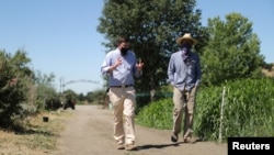 Head of School Christopher Barnes walks through the campus of Midland School with Farm Manager Nick Tranmer, as the global outbreak of the coronavirus disease (COVID-19) continues, in Los Olivos, California, U.S., July 20, 2020. (REUTERS/Lucy Nicholson)