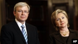 (FILE PHOTO) Secretary of State Hillary Rodham Clinton and Australian Prime Minister Kevin Rudd meet with reporters in the Benjamin Franklin Room of the State Department in Washington, Tuesday, March 24, 2009. (AP Photo/Haraz N. Ghanbari)