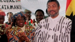 FILE - Nana Konadu Agyeman-Rawlings (L), then first lady of the Republic of Ghana and her husband, then president of Ghana Jerry John Rawlings, are seen during a visit to Denver, Colorado, in an April 24, 1999, photo.