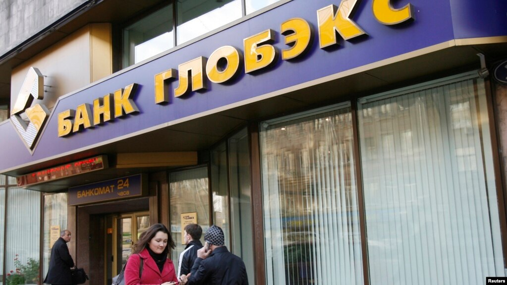 FILE   People Walk Past A Globex Bank Office In Moscow, Oct. 16,
