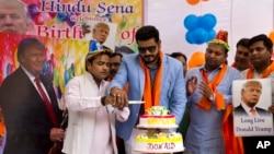 Members of Hindu nationalist 'Hindu Sena' or Hindu Army, cut a cake to celebrate the birthday of U.S presidential candidate Donald Trump.