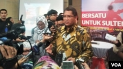 Menteri Komunikasi dan Informatika Rudiantara menjelaskan di Jakarta. Selasa (2/10). (VOA/A.Bhagaskoro)