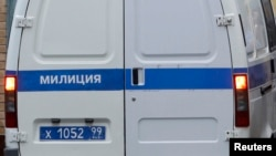 FILE - A police minivan is seen entering a Moscow detention facility.
