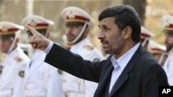 Iranian President Mahmoud Ahmadinejad gestures prior to an official welcoming ceremony for Qatari Emir Sheik Hamad Bin Khalifa Al Thani, unseen, in Tehran, Iran, 20 Dec 2010