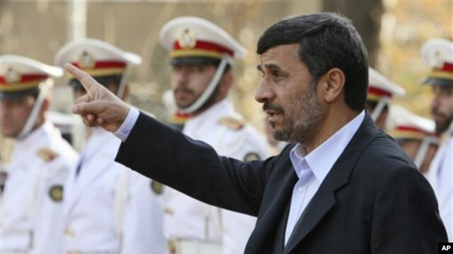 Iranian President Mahmoud Ahmadinejad gestures prior to an official welcoming ceremony for Qatari Emir Sheik Hamad Bin Khalifa Al Thani, unseen, in Tehran, Iran, 20 Dec 2010