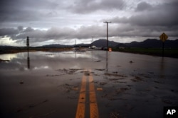 Water covers a closed Las Posas Road near Camarillo, Calif., after heavy rain from the first in a series of El Nino storms passed over the area on, Jan. 6, 2016.