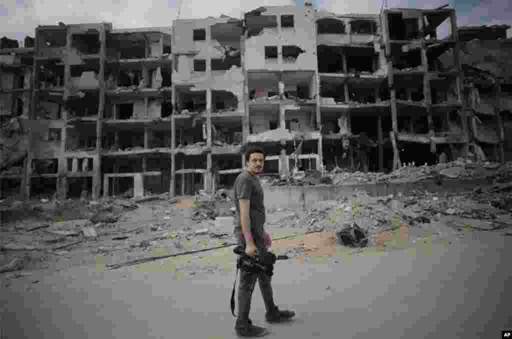 This Monday, Aug. 11 2014 photo shows Associated Press video journalist Simone Camilli in Beit Lahiya, Gaza Strip. Camilli, 35, was killed in an ordnance explosion in the Gaza Strip, on Wednesday, Aug. 13, 2014 together with Palestinian translator Ali She