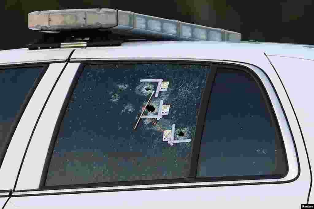 An East Baton Rouge Sheriff vehicle is seen with bullet holes in its windows near the scene where police officers were shot, in Baton Rouge, Louisiana, July 17, 2016.