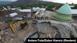 FILE - An aerial view of the collapsed Jamiul Jamaah mosque where rescue workers and soldiers search for earthquake victims in Pemenang, North Lombok, Indonesia, Aug. 8, 2018. (Antara Foto/Zabur Karuru/ via Reuters)