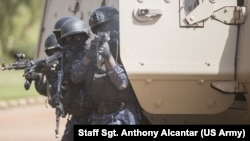 A Burkinabe police officer with the Special Intervention Unit fires his AK-47 rifle during a simulated terrorist attack as part of exercise Flintlock 2019 in Ouagadougou, Burkina Faso, Feb. 27, 2019.