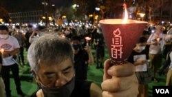 香港理工大學應用社會科學系前助理教授鍾劍華表示,香港人對六四事件的記憶不容易被清洗, 他相信支聯會解散之後,每年六四悼念的燭光會由維園散落全球。(美國之音湯惠芸)