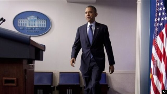 President Barack Obama approaches podium to discuss about the economy, White House, June 8, 2012.