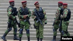 Kenyan paramilitary units take their positions during the Africa Union Peace and Security Council Summit on Terrorism, at the Kenyatta International Convention Centre, in Nairobi, Sept. 2, 2014.