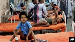 Indian children who fell ill after eating the daily free lunch at a rural Indian school undergo treatment at a hospital in Patna, India, July 18, 2013.