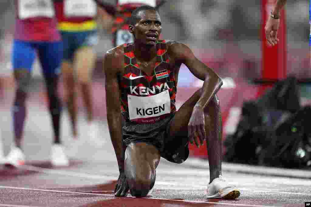 Benjamin Kigen, of Kenya, reacts after the men's 3,000-meter steeplechase final at the 2020 Summer Olympics, Monday, Aug. 2, 2021, in Tokyo. (AP Photo/Petr David Josek)