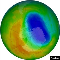 FILE - A false-color view of total ozone over the Antarctic pole is seen in this NASA handout image released Oct. 24, 2012. The purple and blue colors are where there is the least ozone. The average area covered by the Antarctic ozone hole in that year was the second smallest in two decades, at 8.2 million square miles; in September 2017, it was 7.6 million square miles.