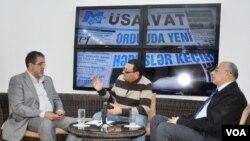 Azadlıq qəzetinin baş redakorunun birinci müavini Rahim Hacıyev və Yeni Müsavat qəzetinin baş redaktoru Rauf Arifoğlu