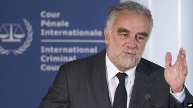 International Criminal Court prosecutor Luis Moreno-Ocampo gestures during a news conference in The Hague, Netherlands, Tuesday Jan. 24, 2012.