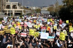 FILE - Iranian worshippers chant slogans in a rally after Friday prayer in Tehran, Iran, Dec. 8, 2017. Hundreds rallied to show their anger after the Trump administration's recognition of Jerusalem as Israel's capital.