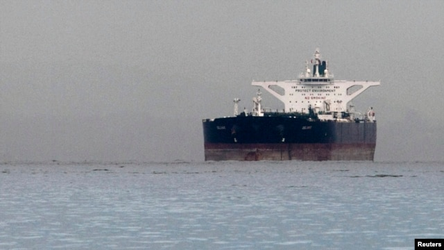 "FILE - Malta-flagged Iranian crude oil supertanker ""Delvar"" is seen anchored off Singapore, March 1, 2012."
