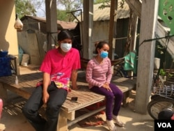 Seang Naroth and Seng Va seated at their family home in Bati district, Takeo province, a day after they completed their 14-day isolation period on April 7, 2020. (Ananth Baliga/VOA Khmer)