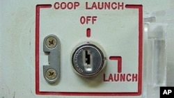 FILE - Launch key mechanism at the deactivated Delta Nine Launch Facility near Wall, South Dakota.