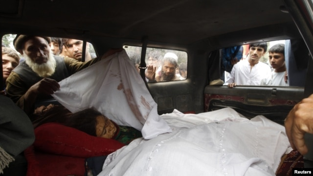 Afghan villagers look at the bodies of women allegedly killed by NATO air strikes in Laghman province September 16, 2012.