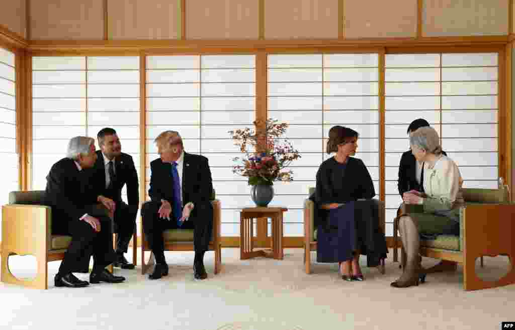 U.S. President Donald Trump talks with Japan's Emperor Akihito while his wife Melania talks with Empress Michiko at the Imperial Palace in Tokyo.