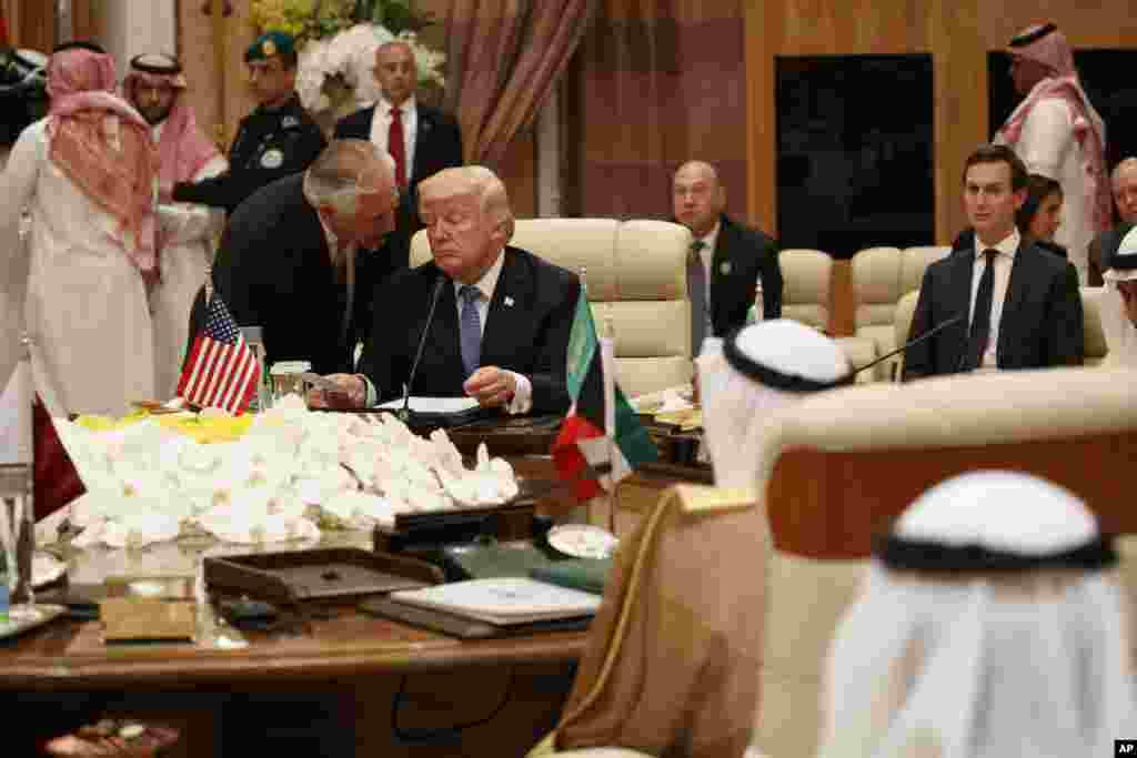U.S. Secretary of State Rex Tillerson, left, speaks with President Donald Trump during a meeting with leaders at the Gulf Cooperation Council Summit, at the King Abdulaziz Conference Center in Riyadh, Saudi Arabia, May 21, 2107.