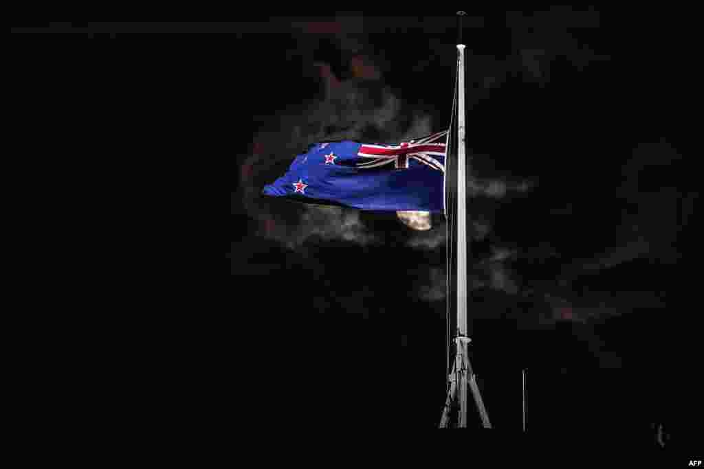 The New Zealand national flag is flown at half-mast on a Parliament building in Wellington after attacks on two Christchurch mosques left at least 49 dead on March 15, with one gunman identified as an Australian extremist, apparently livestreaming the assault that triggered the lockdown of the New Zealand city.
