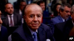 Former Argentine President Carlos Menem sits in a courthouse in Buenos Aires, Feb. 28, 2019, ahead of the verdict in a trial in which he and other former officials were accused of hampering the investigation of the attack on a Jewish center in Buenos Aires in 1994.