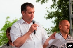 FILE - Anatoly Bokun, leader of strike committee at Belaruskali, a huge potash factory in Soligorsk, speaks to workers in Soligorsk, Belarus, Wednesday, Aug. 19, 2020.
