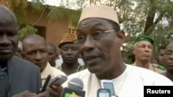 FILE - A still image taken from video shows Mali's then-Defense Minister Abdoulaye Idrissa Maiga speaking to reporters at Gao hospital, in Mali, Jan. 18, 2017. Maiga was named the country's new prime minister April 8, 2017.