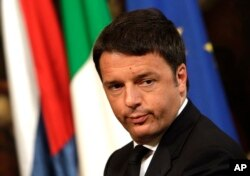 FILE - Italian Prime Minister Matteo Renzi had promised passage of a bill permitting civil unions by late December.