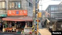 "Pig Rice Supermarket featured in South Korea's Oscar-winning ""Parasite"" is seen in Ahyeon-dong, one of the last shanty towns near downtown Seoul, South Korea February 11, 2019. Picture taken February 11, 2020."