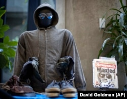 In this file photo from May 18, 2011, the hoodie and sunglasses used by Ted Kaczynski, also known as the Unabomber, are displayed as Kaczynski's personal items are auctioned off online with proceeds to benefit the victims' families in Atlanta.