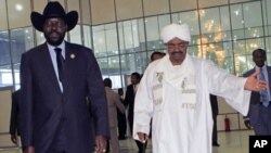 Sudan's President Omar al-Bashir welcomes his South Sudanese counterpart Salva Kiir for his first visit since southern secession to discuss key unresolved issues that have undermined north-south relations, during his arrival at Khartoum Airport, Sudan, Oc