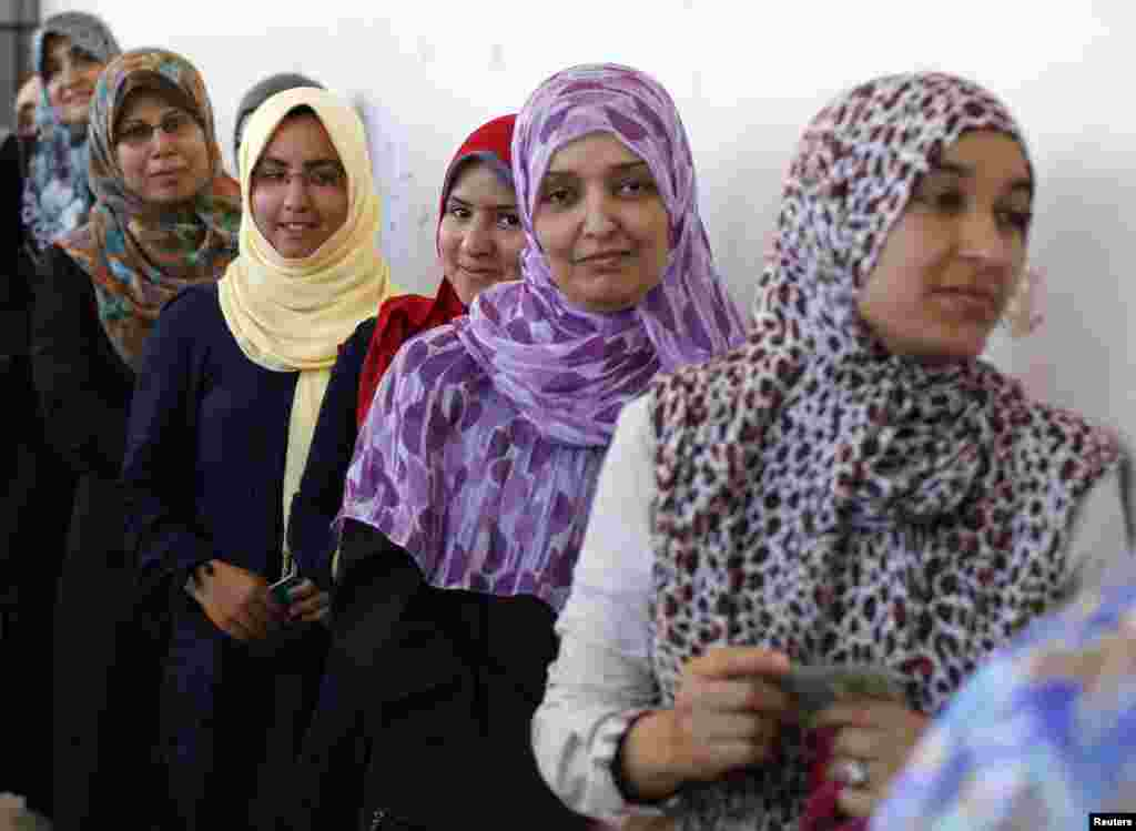 Women line up as they wait to cast their vote at a polling station in Tripoli July 7, 2012. Libyans began voting in their first free national election in 60 years on Saturday, a poll designed to shake off the legacy of Muammar Gaddafi but which risks bein
