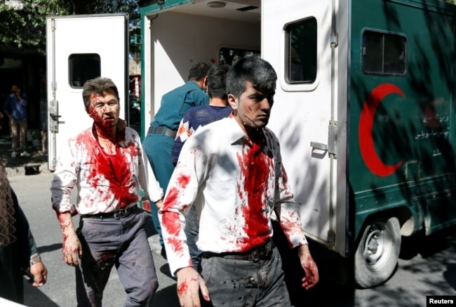 Injured Afghan men arrive at a hospital after a blast in Kabul, Afghanistan, May 31, 2017.
