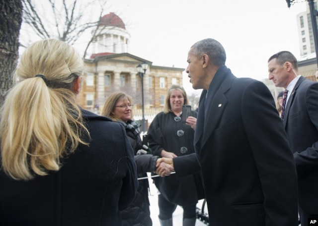 President Barack Obama, prior to his speech to the Illinois General Assembly, stops to greet people across from the Old State Capitol building in Springfield, Ill., Feb. 10, 2016.