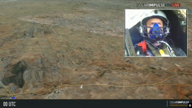 This screen grab from the Solar Impulse live stream shows Swiss pilot and businessman, Andre Borschberg, as he flies his solar plane over the Moroccan desert, June 13, 2012.